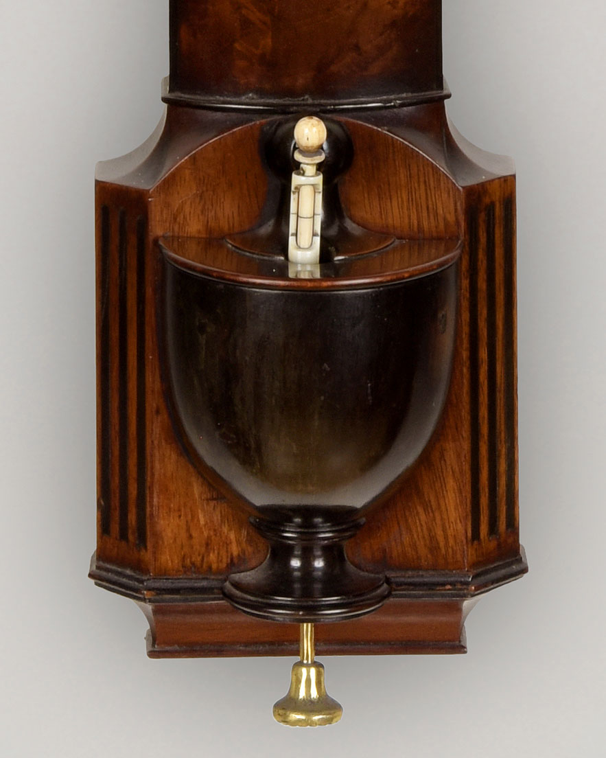 WEST, LONDON. A rare, figured mahogany bow front stick barometer.