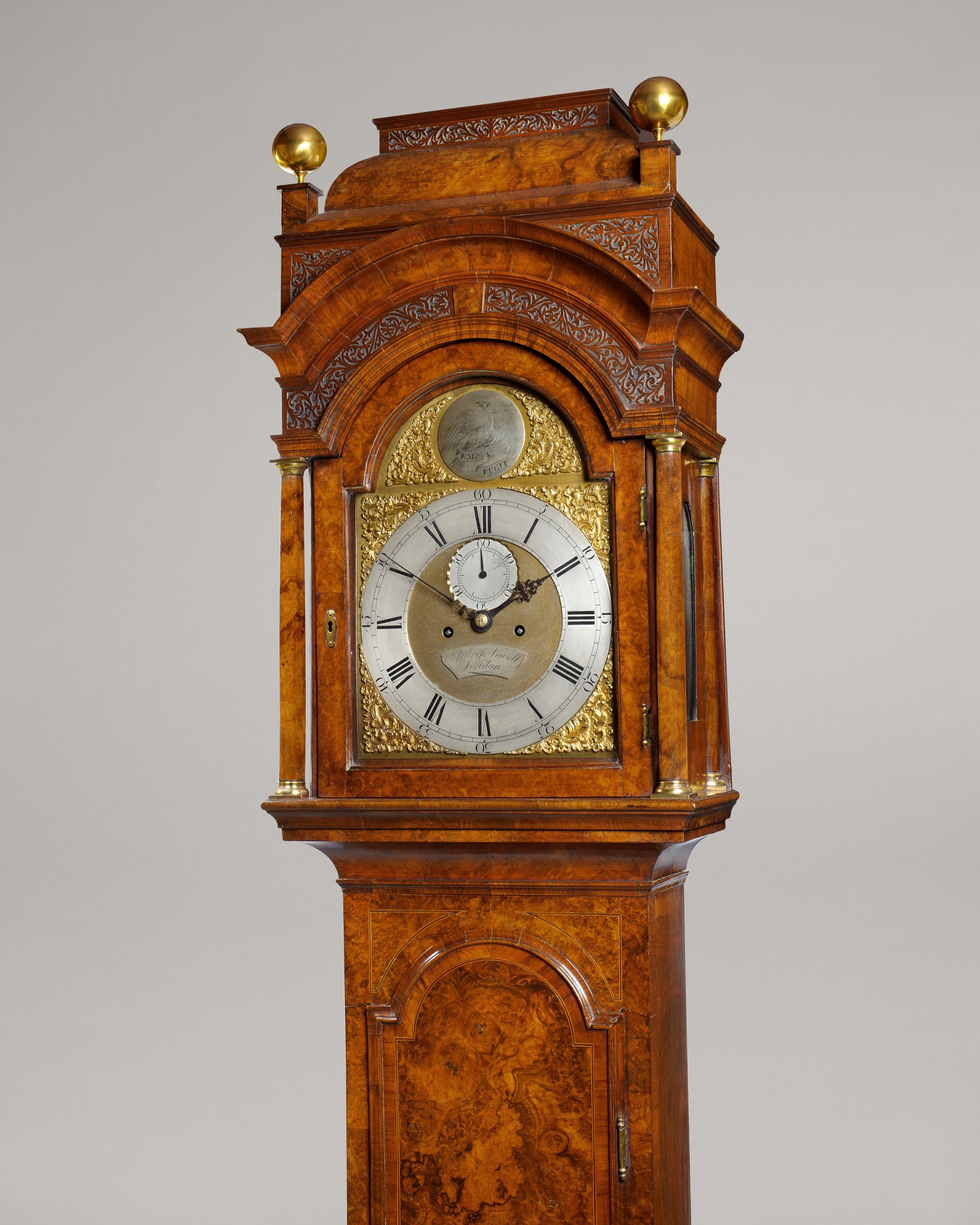 AMBROSE VOWELL. A FINE GEORGE II PERIOD FIGURED WALNUT LONGCASE CLOCK WITH BREAK ARCH DIAL AND ORIGINAL CADDY TOP.
