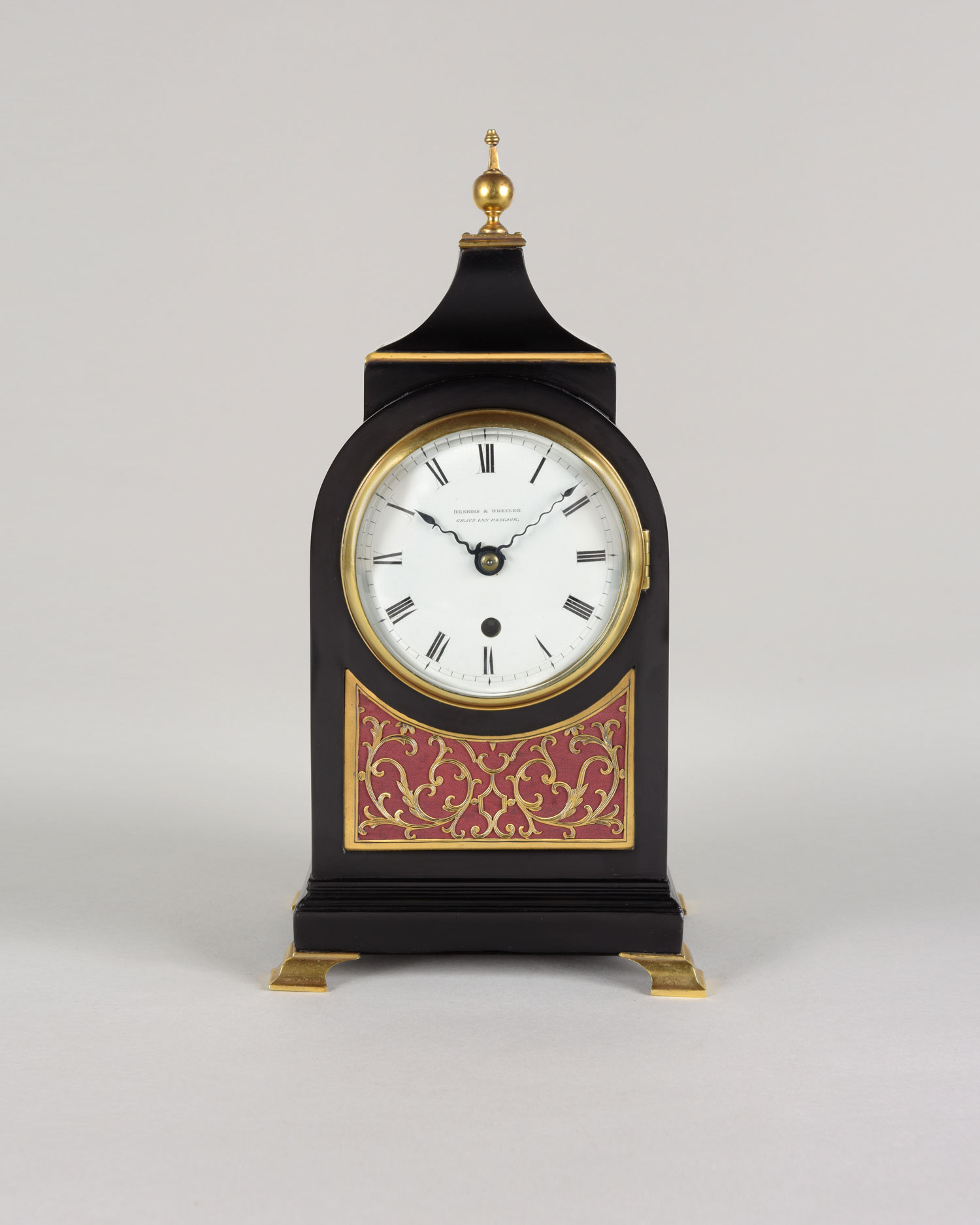 DESBOIS & WHEELER. A small Regency period ebonised mantel clock