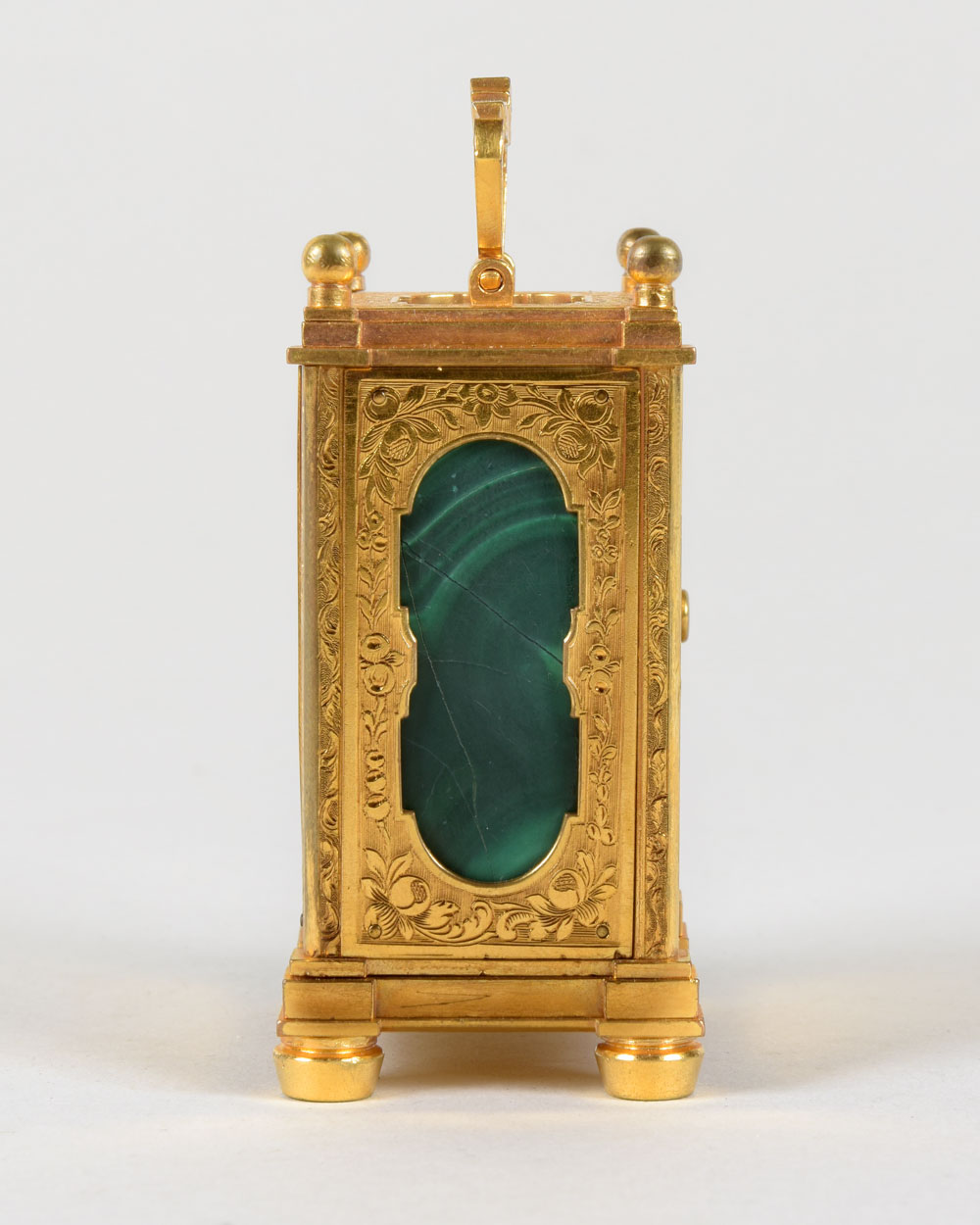 HUNT & ROSKELL supplied by  Thomas Cole.An exceptionally rare gilt engraved miniature carriage timepiece with malachite panels