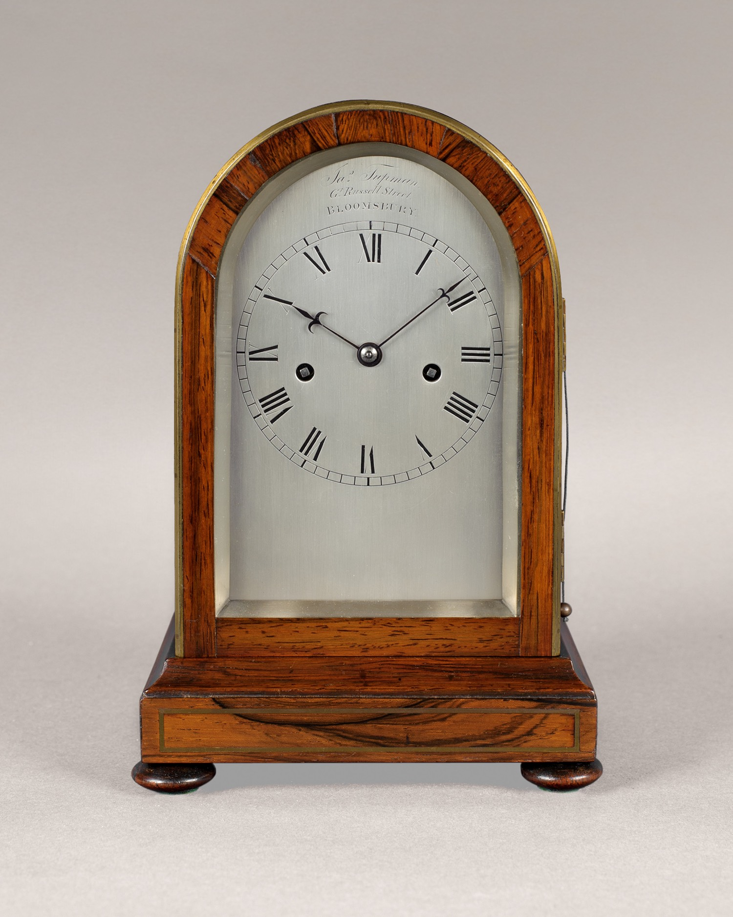 JAMES TUPMAN, A MINIATURE REGENCY ROSEWOOD AND BRASS INLAID MANTEL CLOCK