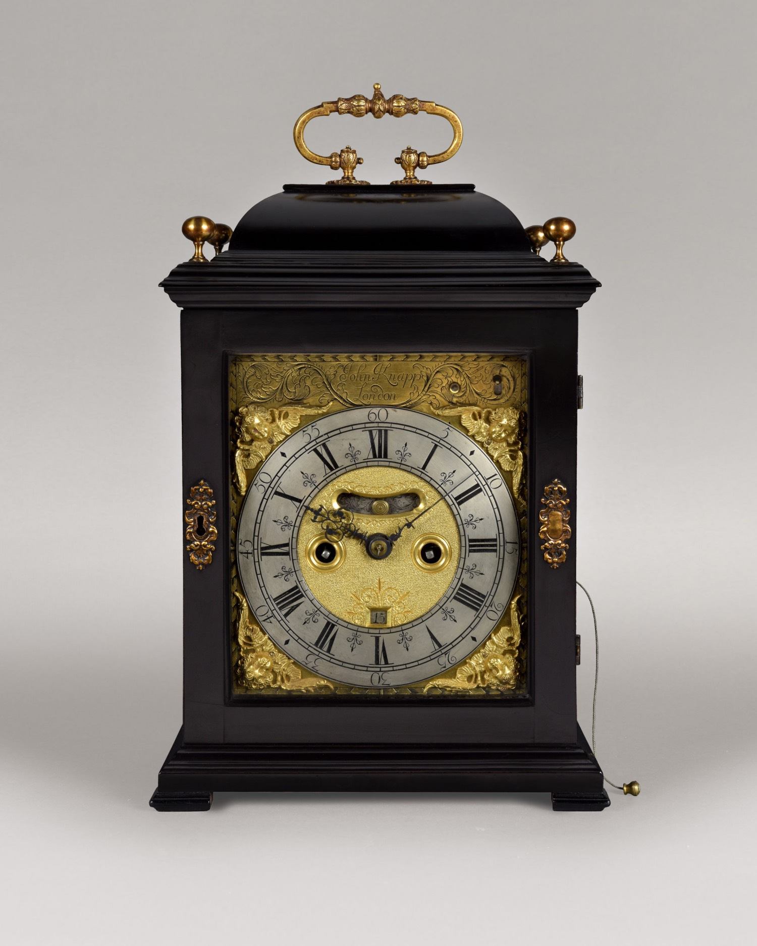 JOHN KNAPP. A QUEEN ANNE PERIOD EBONISED HOUR-STRIKING TABLE CLOCK.